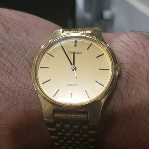 Pulsar mens gold tone watch V5018l-8A50